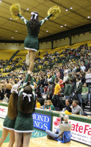 College cheerleaders lead a chant in a January home game. ALISON COHEN / THE FLAT HAT