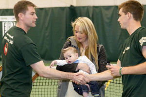 Alex Fish '06 receives a token of support from the men's tennis program Sunday. COURTESY PHOTO / TRIBE ATHLETICS