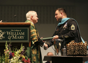 College of William and Mary Chancellor Robert Gates '65 introduces Sergeant First Class Leroy Petry, who served as this year's Commencement speaker. COURTESY PHOTO / WM.EDU