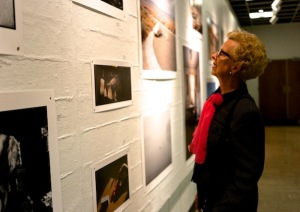 One of the many viewers who enjoyed the exhibit during opening night. CAROL PENG / THE FLAT HAT