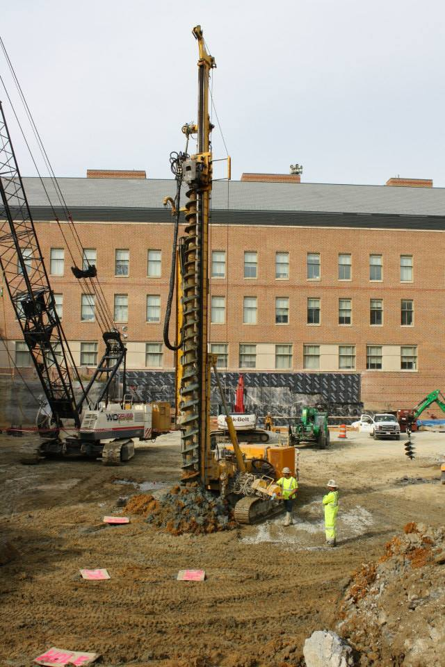 This is the earliest stage of construction on the base of ISC 3. The large drill depicted is creating multiple holes in the ground, which will be filled with heavy material, using compression to pack the dirt together and create a strong base for the new building.  BAILEY KIRKPATRICK / THE FLAT HAT