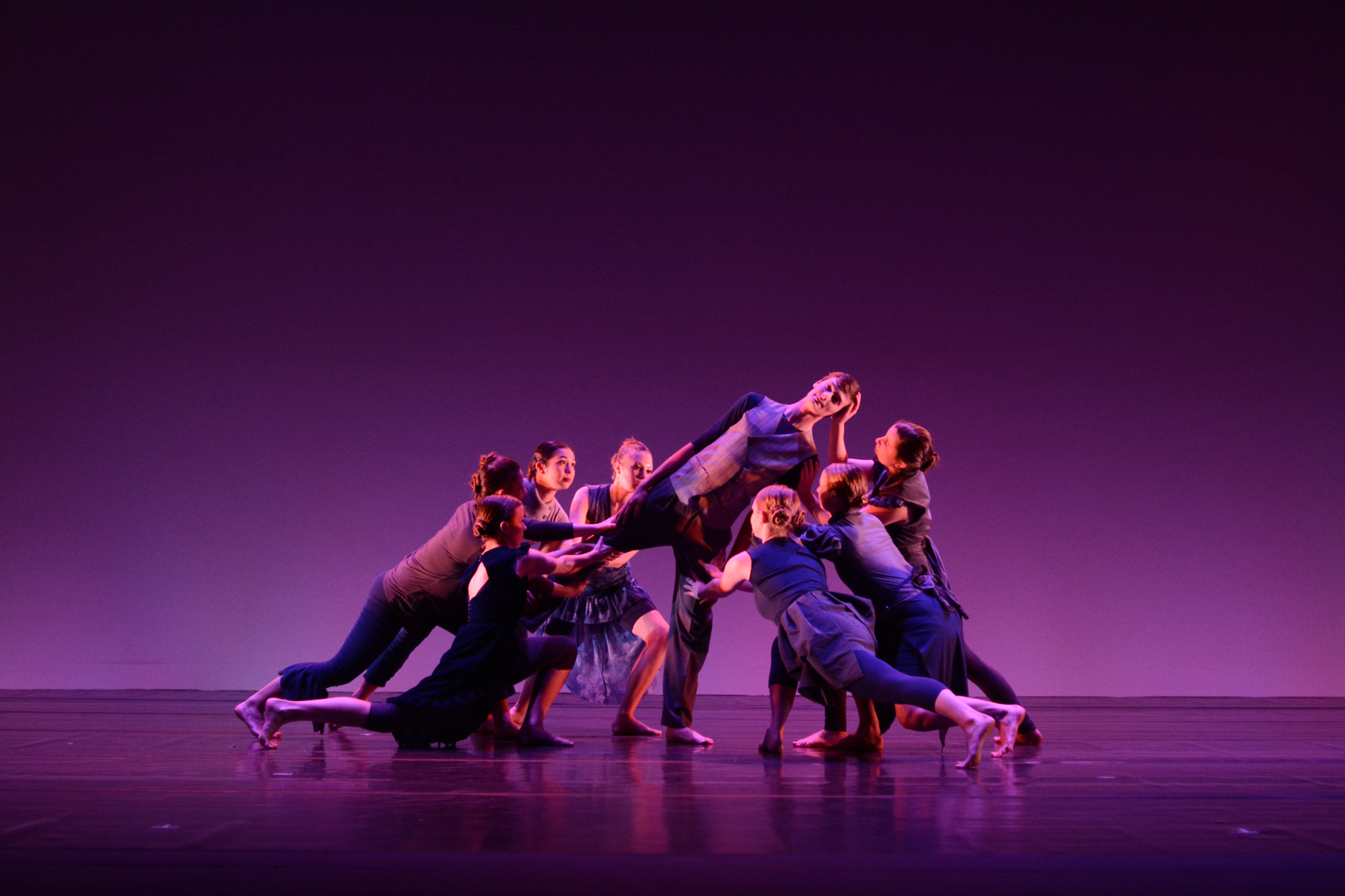 """""""The Risk of Standing Still"""" featured dark costumes and minimal lighting, with dancers performing slow, subtle movements juxtaposed against abrupt arm swings and placement changes. COURTESY PHOTO / GEOFF WADE"""