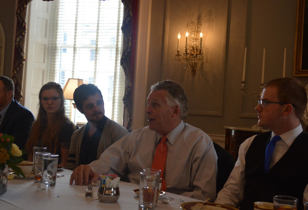 McAuliffe hosts luncheon to discuss student journalism, high points of his career