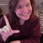 """COURTESY PHOTO / ALLISON SHOMAKER. ASL Club president Allison Shomaker signs the letter """"L"""" in ASL."""