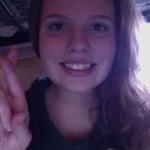 "COURTESY PHOTO / JENNIFER HARTLEY. Club member Jennifer Hartley signs ""R"" in ASL."