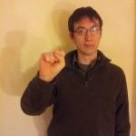 """COURTESY PHOTO / STEPHEN MCINTURFF. Club member Stephen McInturff signs """"S"""" in ASL."""