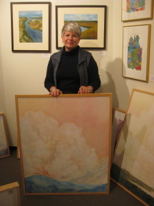 Chee Kludt Ricketts displaying one of her paintings. SARAH RUIZ / THE FLAT HAT