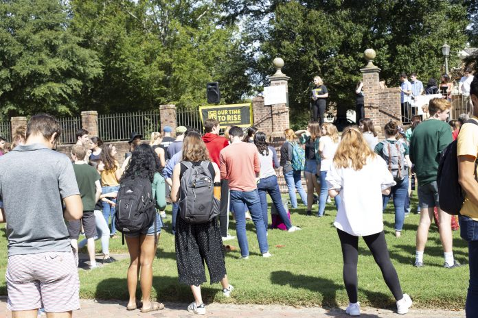 Students gather on the Sunken Gardens to listen to speakers in the Climate Strike